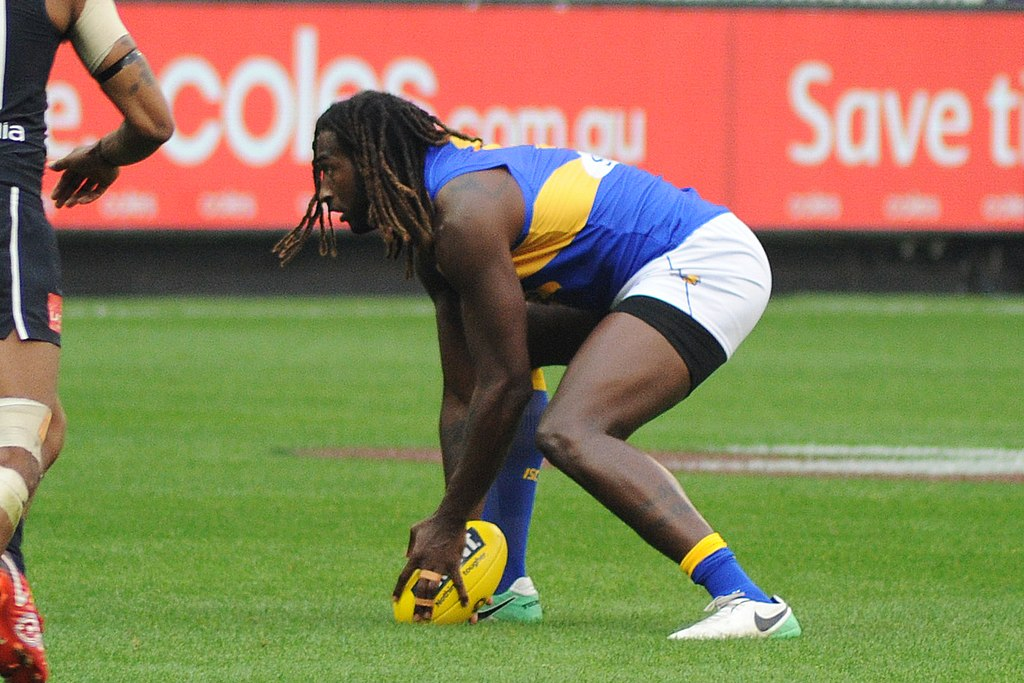 Featured Image BY Flickerd // Nic Naitanui ball pick up during the AFL round five match between Carlton and West Coast on 21 April 2018 at the Melbourne Cricket Ground in Melbourne, Victoria. // (https://commons.wikimedia.org/wiki/File:Nic_Naitanui_ball_pick_up.jpg) // CC BY-SA (https://creativecommons.org/licenses/by-sa/4.0)