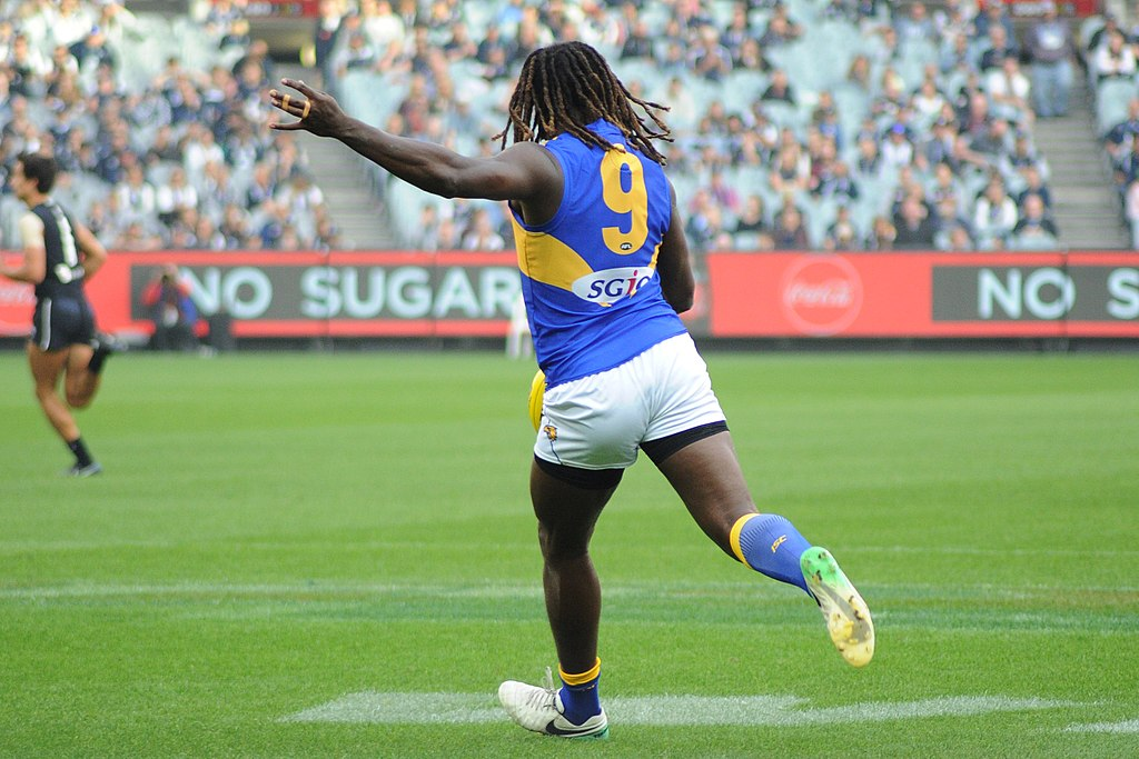 Featured Image By Flickerd // Nic Naitanui kicking during the AFL round five match between Carlton and West Coast on 21 April 2018 at the Melbourne Cricket Ground in Melbourne, Victoria // https://commons.wikimedia.org/wiki/File:Nic_Naitanui_kicking.1.jpg // CC BY-SA (https://creativecommons.org/licenses/by-sa/4.0)